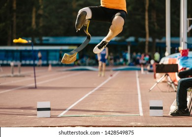 athlete amputee on prosthetic leg long jump competition at athletics