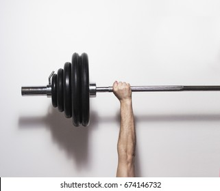 athlete bodybuilder, holding in hand a barbell, muscular hand on a white background, flat, minimalism, concept sports lifestyle