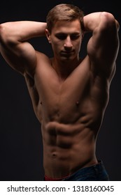 Athlete, bodybuilder, on black. Gym advertising, fitness, sports club. Healthy lifestyle concept