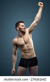 Athlete businessman showing his internal strength