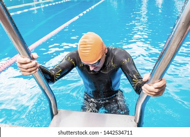 Athlete comes out of the swimming pool after training before the championship