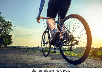 Athlete cycling on the road in the afternoon.