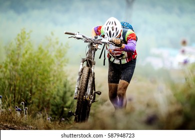 athlete cyclist mountainbiker going uphill with my bike