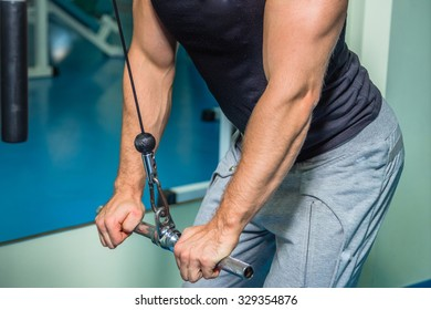 The athlete demonstrates muscles while bench dumbbell. Work on your body and achieve the goal. Photos for sporting magazines and websites.
