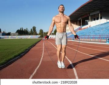 Athlete doing exercize at the stadium