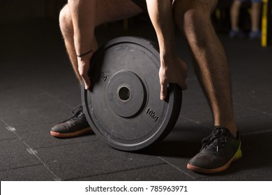 Athlete doing plate exercises
