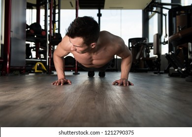 Athlete Doing Push-Up As Part Of Bodybuilding Training