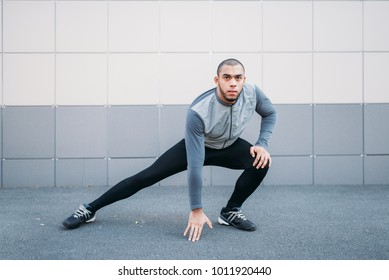 Athlete doing stretching exercise before running