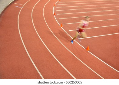 athlete during indoor track race