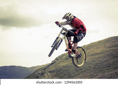 athlete engaged downhill with mtb