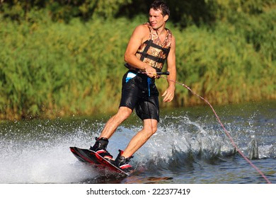 athlete enjoys skateboarding on the river and looking away