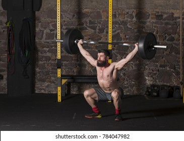Athlete executing olympic lifts
