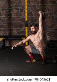 Athlete exercising kettlebell drills