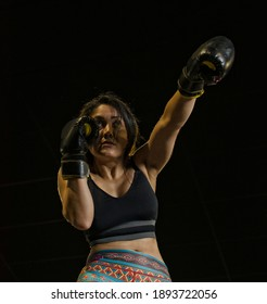 Athlete female punching in the air