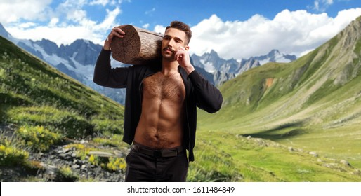 Athlete, fit, sexy, muscle brutal man with moustache and haircut, with naked torso, holding a tree trunk on his shoulders, over alpine mountain background.
