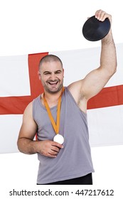 Athlete with game gold medal and england flag in background