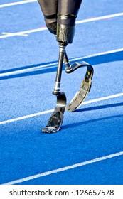 athlete with handicap walks to the start