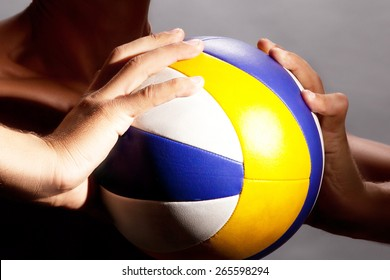 the athlete holds a volleyball