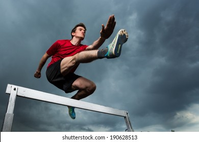athlete hurdling in track and field
