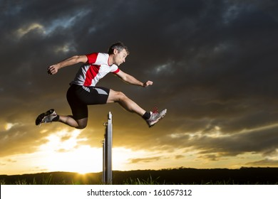 athlete in hurdling in track and field in sunrise