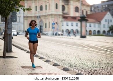 Athlete jogger woman on street - workout concept