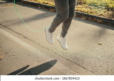 athlete jumping rope training in the Park. a young man is playing sports on the street
