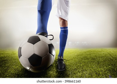 Athlete kicking soccer ball