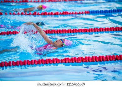 Athlete kid swimming in backstroke competition