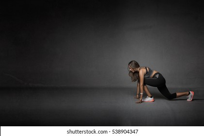 athlete made stretching, dark background