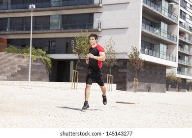 athlete male running at the city park