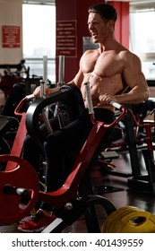 athlete man doing exercise with pull-down mashine in the gym