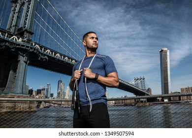 Athlete man with jump rope ready for outdoors workout in New York City