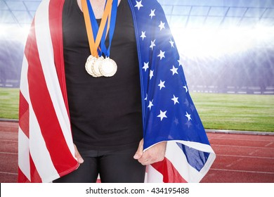 Athlete with olympic gold medal against race track