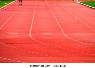Athlete on track in the stadium