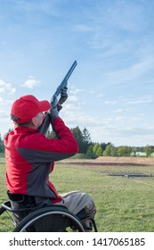 athlete on a wheelchair shoots skeet in a sports club