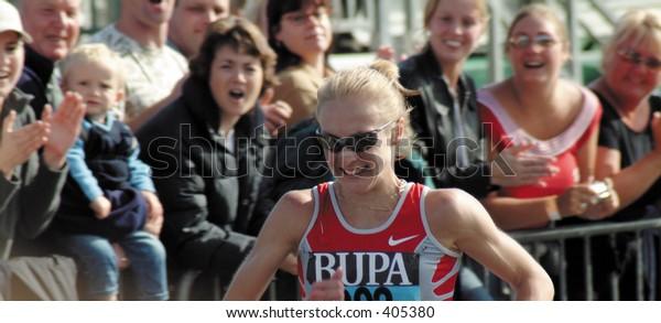 Athlete Paula Radcliffe breaking record at Great North Run, 2003