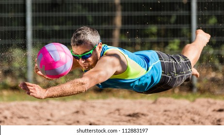 athlete playing beachvolleyball
