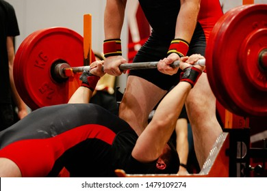 athlete powerlifter start attempt bench press competition in powerlifting