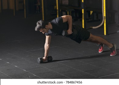 Athlete practicing dumbbell exercises