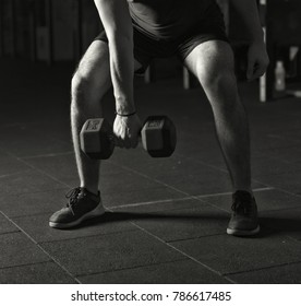 Athlete practicing dumbbell snatches