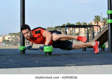 Athlete practicing exercises of calisthenics on a sunny day