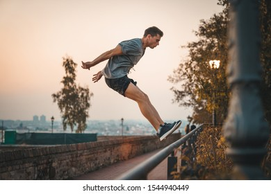 Athlete practicing jumping. Free running parkour - Stock photo