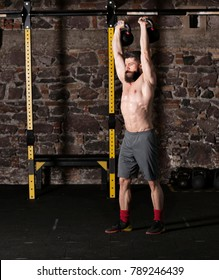 Athlete practicing kettlebell thrusters