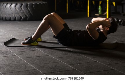 Athlete practicing sit-ups