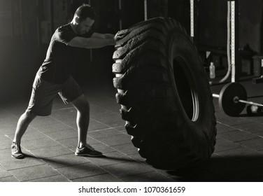 Athlete practicing tire flips
