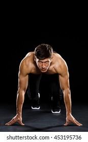 Athlete prepare to run over black background