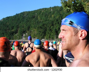 Athlete preparing for swimming portion of a triathlon, selective focus