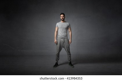 athlete ready for work out. dark background