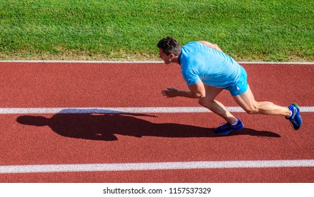 Athlete run stadium green grass background. Runner sporty shape in motion. Sport lifestyle and health concept. Man athlete run to achieve great result. Impulse to move. Life non stop motion.