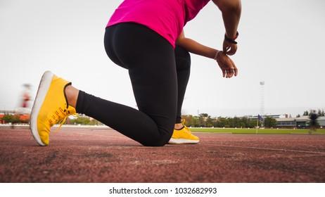 Athlete runner feet running on road closeup on shoe. woman fitness jog workout wellness concept.